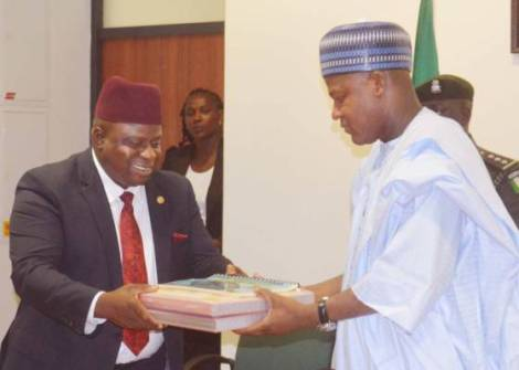 Speaker, House of Representatives, Rt. Hon. Yakubu Dogara (right) receiving the  report of  12-day Medical Outreach he sponsored in Bauchi State from the team leader of Doctors on the Move Africa, Dr. Joseph Kigbu, at the National Assembly on Wednesday 18th May, 2016.