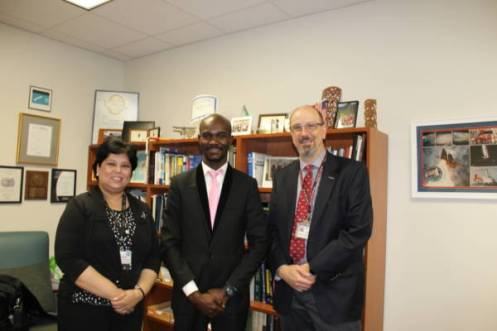 Runcie C.W. Chidebe, Executive Director of Project PINK BLUE (centre), with Dr. Oliver Bogler, Senior Vice President Academics Affairs (right), and Dr. Shubhra Ghosh, Project Director, Global Programs, UT MD Anderson Cancer Centre, Houston, Texas, USA.