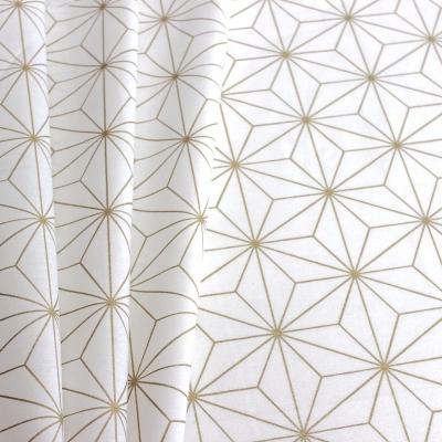 tissu d ameublement a motif geometrique dore et blanc