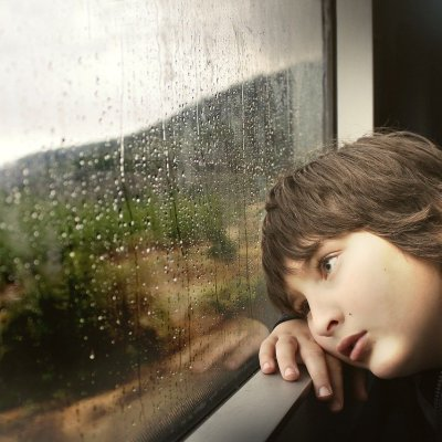 Sad child at window