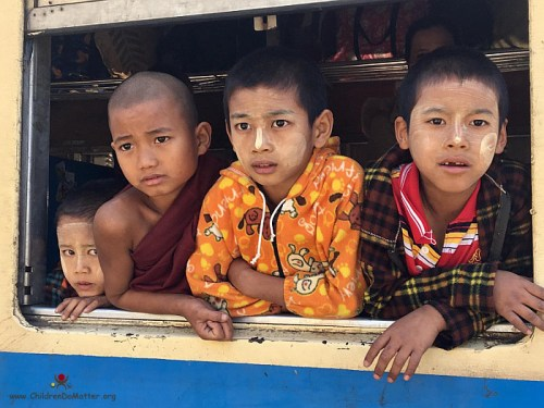 children looking out from the train window - children do matter