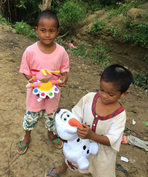 two orphans with toys at sasana orphanage - children do mattter