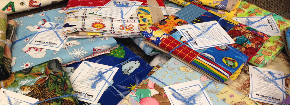 photo of wrapped blanket gifts from Project Linus