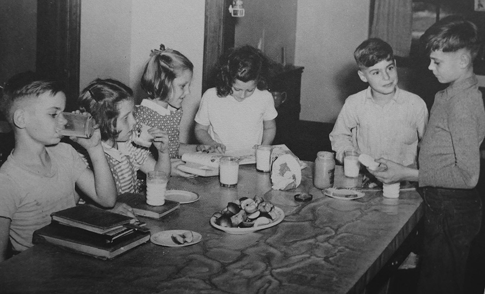 vintage photo of kids having an afternoon snack