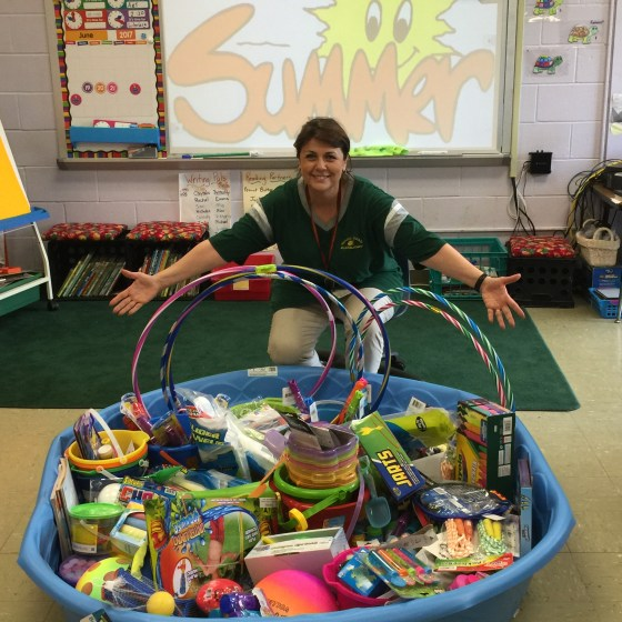 photo of a kiddie pool filled with toy donations