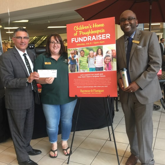 photo of Erin Cafarelli accepting a check from Raymour & Flanigan