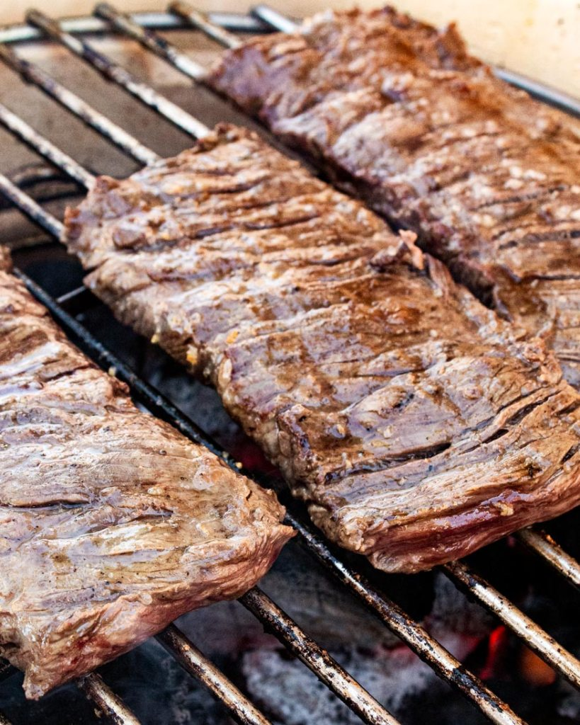 searing the steaks over a hot grill