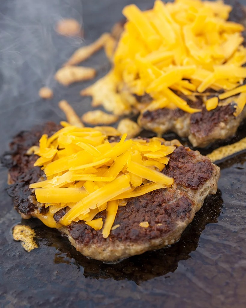 sausage and cheddar grilled on griddle