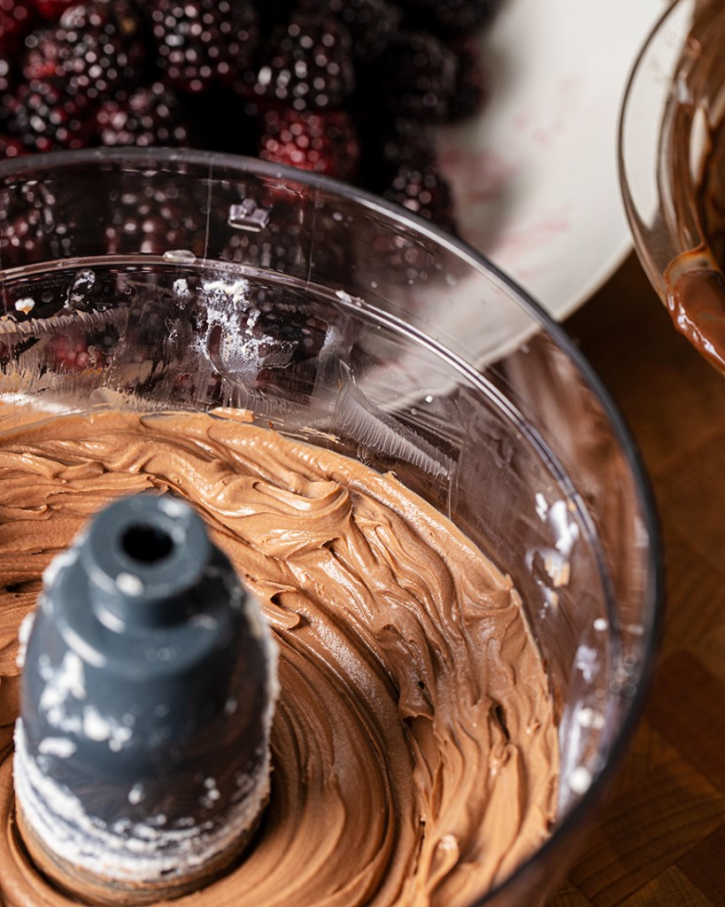 Pouring the smoked chocolate into the ricotta