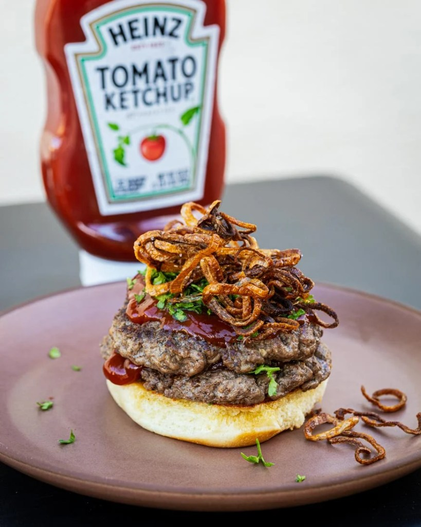 Ketchup is a star with this burger, topped with shallots
