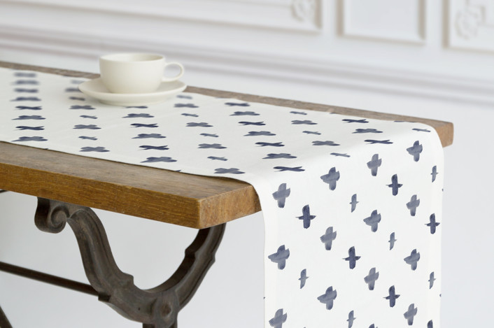 Blue watercolor pluses in a repeat diamond pattern on table runners