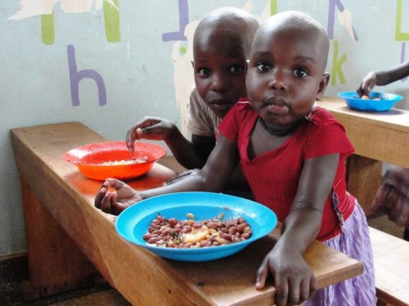 Some of the supported chidren share a meal