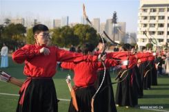 University students perform traditional ritual of archery