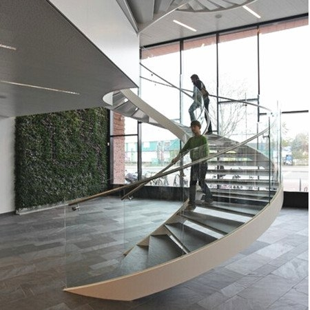 Curved Staircase Curved Stair Demax Arch | Curved Glass Stair Railing | Residential Glass | Commercial Glass | Band Glass | Walnut | Frameless Glass