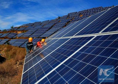 (151029)-- QINHUANGDAO, Oct 29, 2015 (Xinhua) -- Workers construct a solar power field in Qinhuangdao, north China's Hebei Province, Oct. 28, 2015. A 20MW solar power field, established on a mountain in Hebei with an investment of 359 million Yuan (about 56.4 million U.S. Dollars), is expected to be finished and put into operation by the end of November this year. (Xinhua/Yang Shiyao)