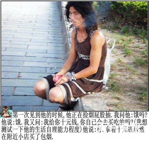 Chinese beggar wearing woman's dress smoking sitting at side of the road