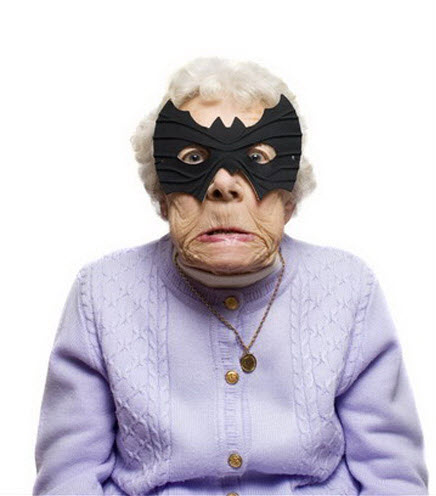 Crazy old lady wearing bat face mask.