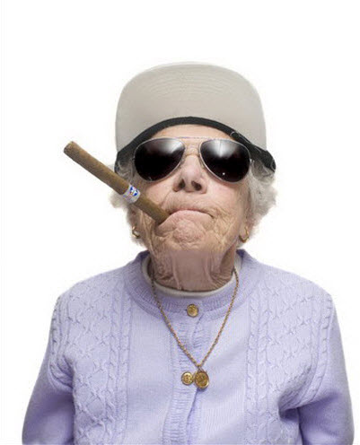 Crazy old lady wearing sunglasses and smoking a cigar.