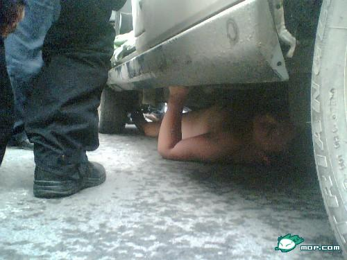 Brother Power escapes under the car.