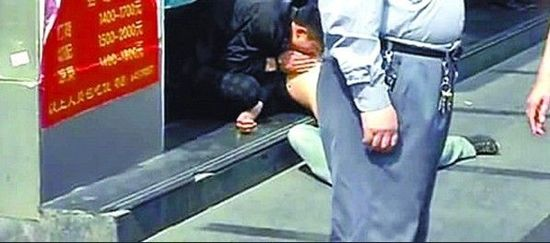 In Shanghai, a man sucks on the naked breast of a woman in broad daylight on a public street.