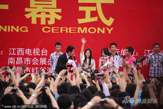 Crowds of Chinese fans take photos of Sora Aoi on stage in Nanchang, China.