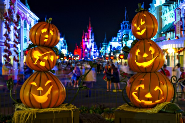 """Stacks of Jack-O-Lanterns frame Cinderella Castle on Main Street, U.S.A. in the Magic Kingdom as decorations set the stage for Mickey's Not-So-Scary Halloween Party. The family-friendly after-hours event offers trick-or-treating, meet and greets with favorite characters in costume, plus the must-see """"Mickey's Boo-to-You Halloween Parade"""" and """"Happy HalloWishes"""" fireworks display. Mickey's Not-So-Scary Halloween Party is a special ticket event and takes place on select nights each fall at Walt Disney World Resort in Lake Buena Vista, Fla. (Ali Nasser, photographer)"""