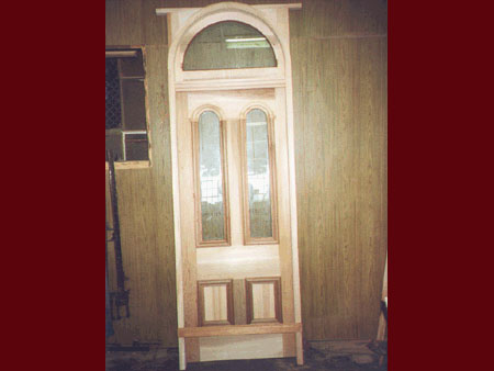 past joinery job arced top victorian front door with arched fanlight in a frame