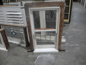 small double hung window with lead light in bottom sash