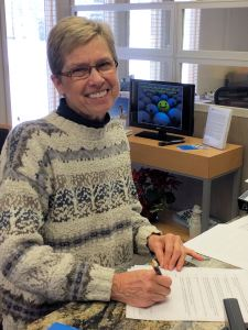 Anne Messinger is ready to sign her new conservation easement