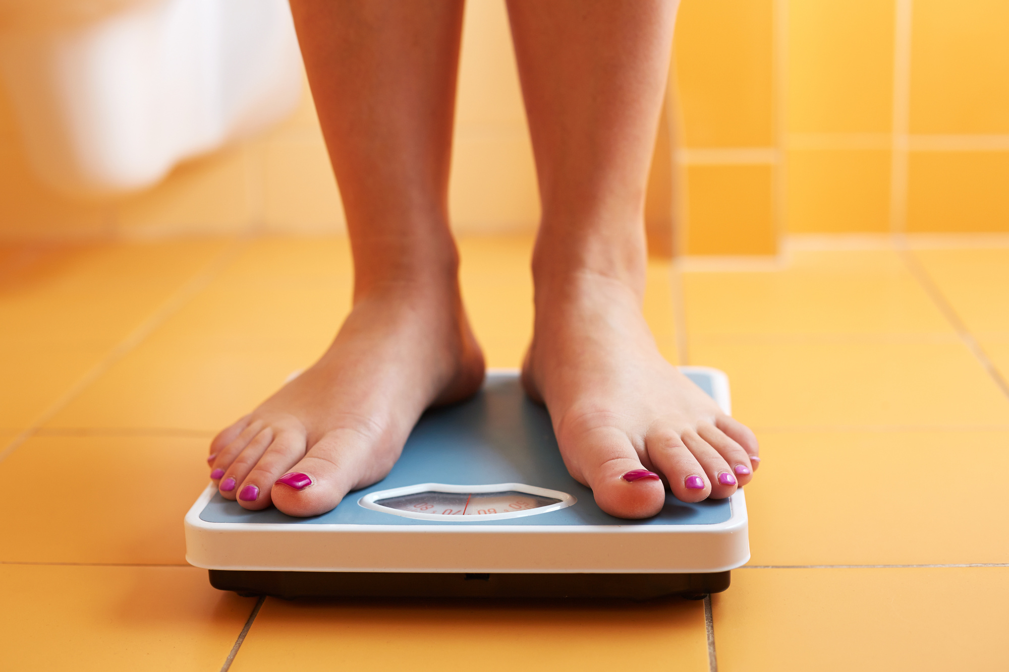 Image result for trying a bathroom scale