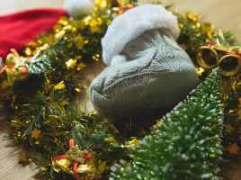baby booties with christmas wreath
