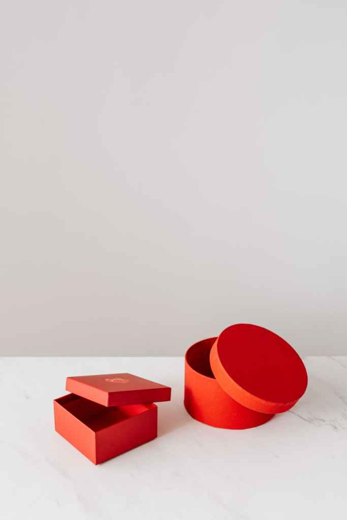 round and square red gift boxes