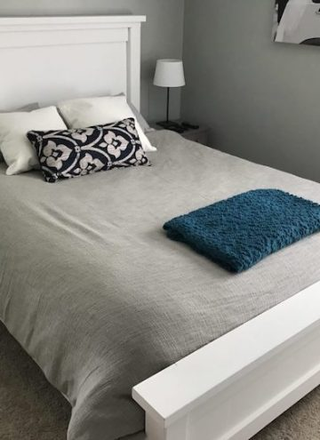 white farmhouse bed with grey comforter