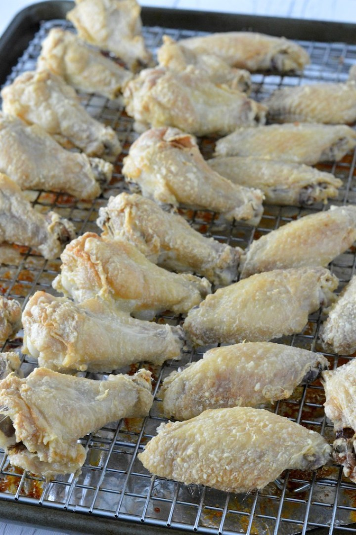 close-up of easy crispy baked chicken wings on baking sheet