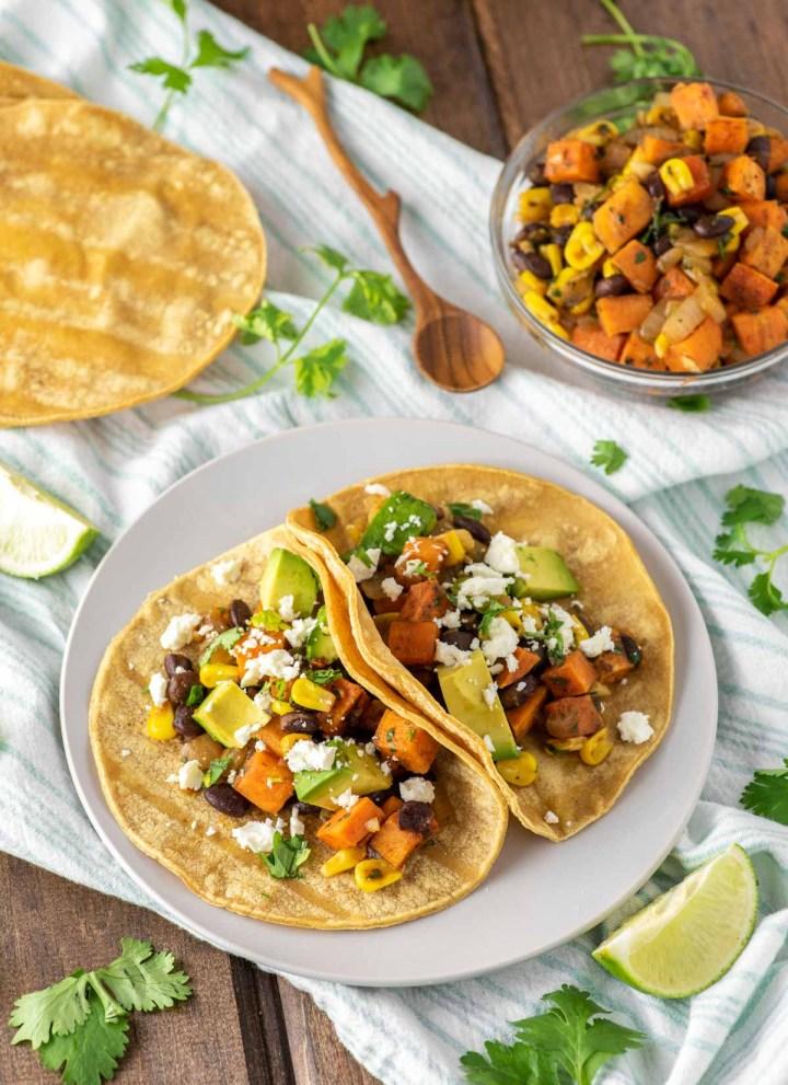 sweet potato black bean tacos on slate plate
