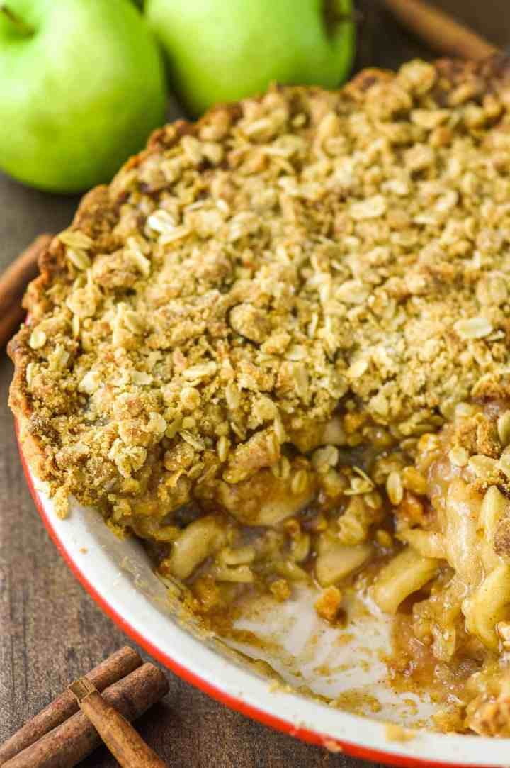 overlay of easy apple crumb pie in red pie dish