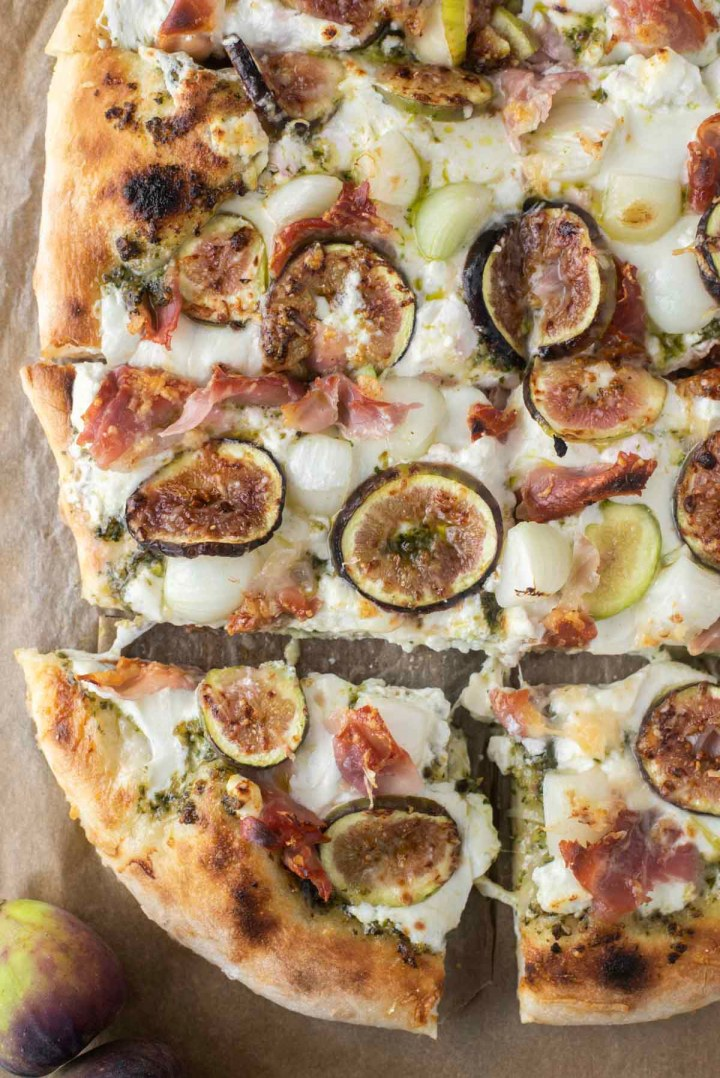 overhead shot of fig pizza on parchment paper