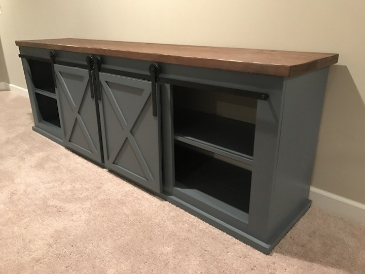 side view of sliding door entertainment center