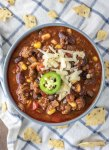 overhead shot of beef chili in blue bowl