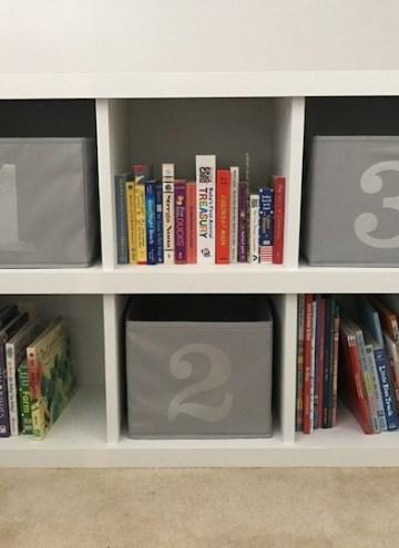white 6 cube bookshelf with books
