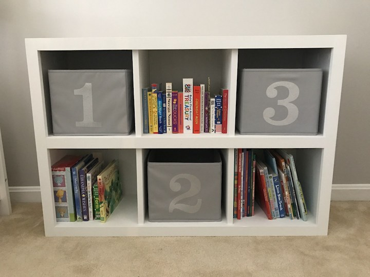white 6 cube bookshelf with books