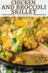 wooden spoon lifting out chicken, farro, broccoli and cheese from skillet