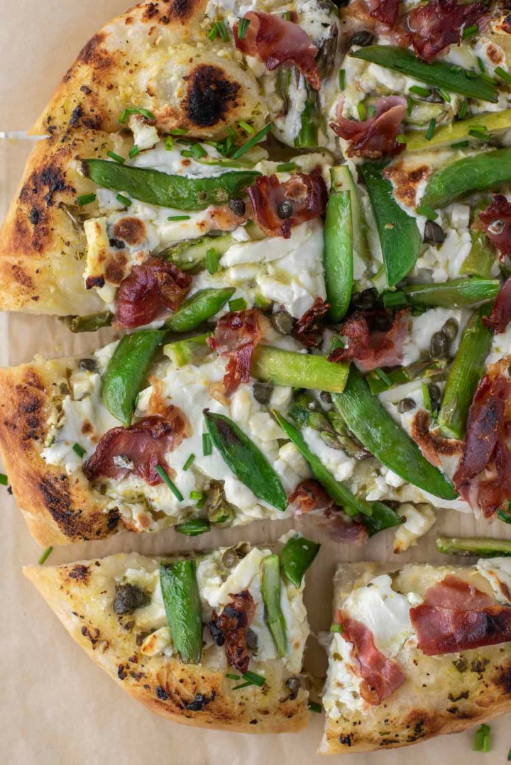 overhead shot of sliced spring pizza
