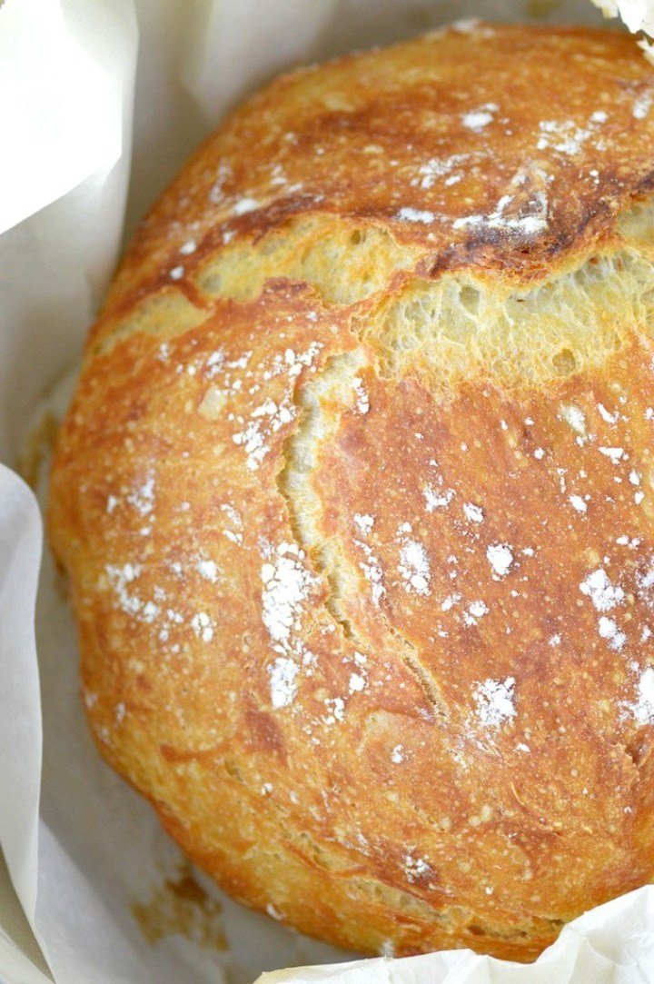 close-up of no-knead dutch oven bread in parchment paper