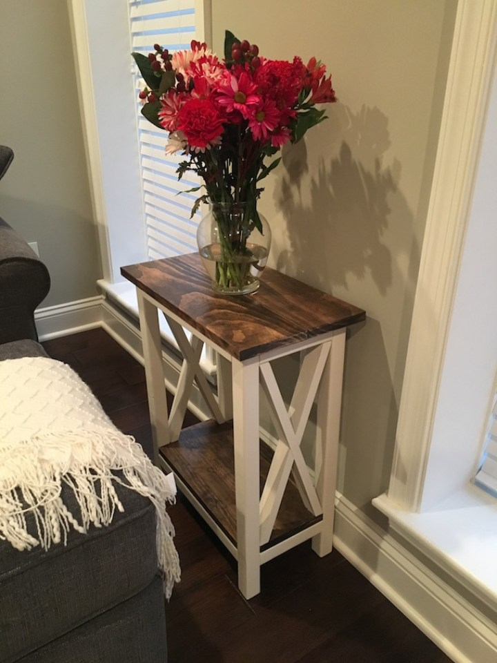 X Side Table with flowers on top