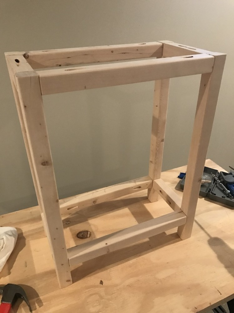 legs for x side table being put together