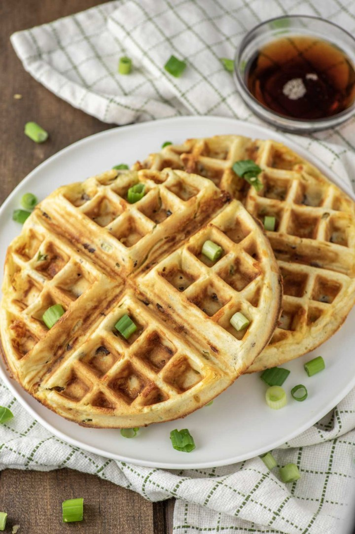 close-up of bacon cheddar waffles on white plate