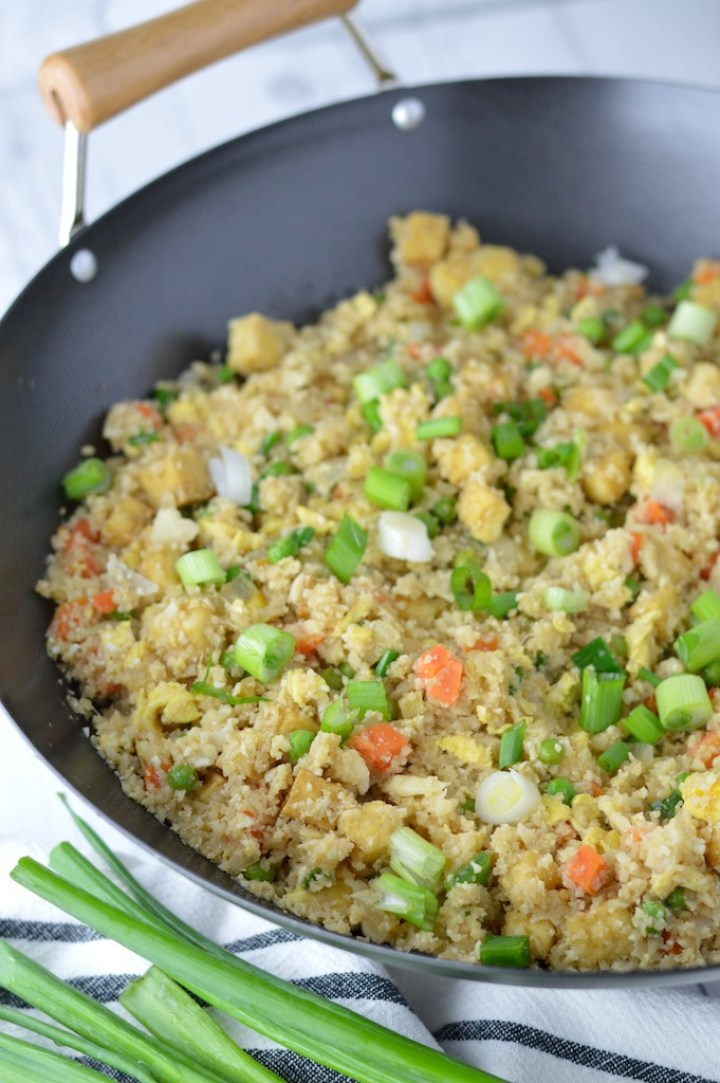 easy cauliflower fried rice in wok with scallions on the side