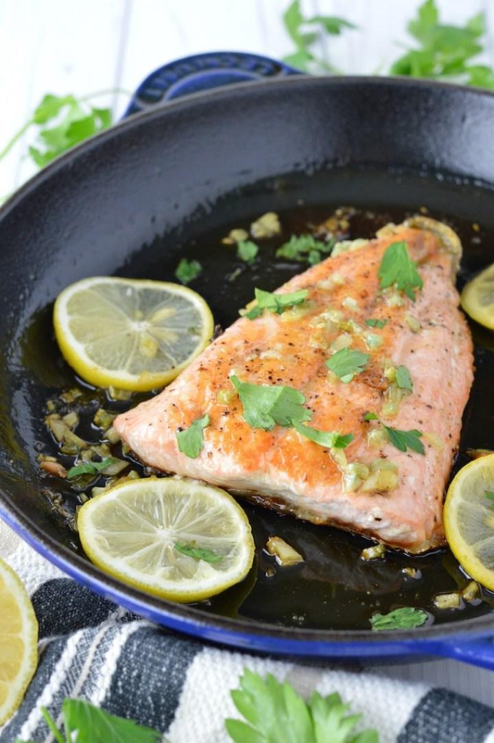 honey garlic salmon in blue skillet