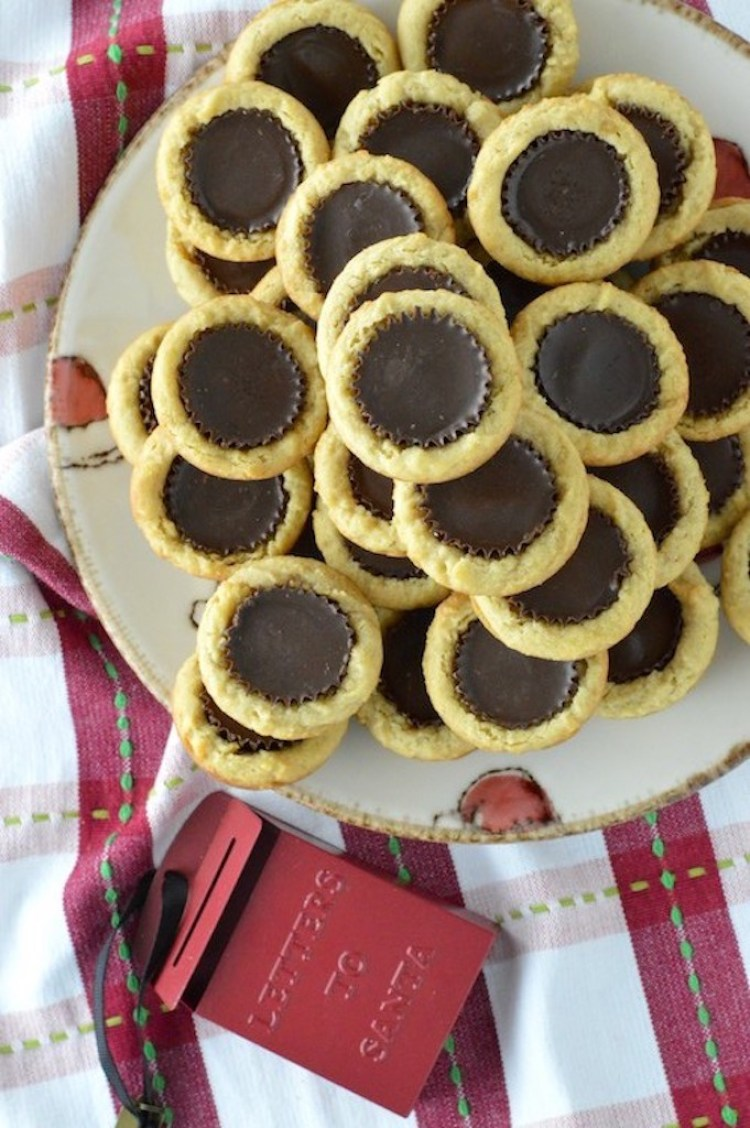 overhead shot of stacked peanut butter cup cookies on plate